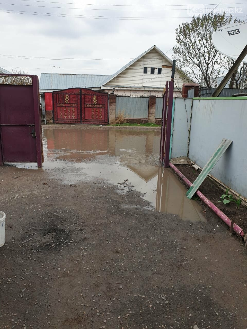Байжарасовское озеро: после дождей на улицах Каскелена появляются новые водоемы, фото-3